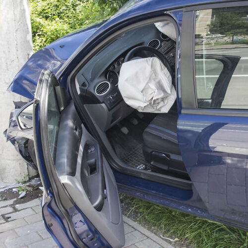 A Wrecked Car With Deployed Air Bag.