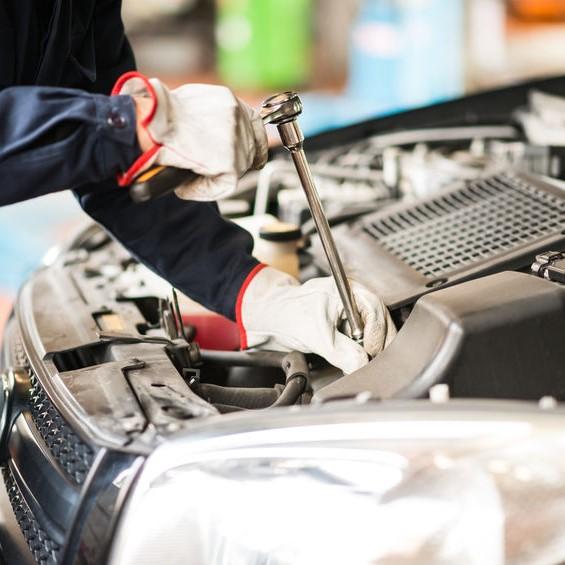 tightening an engine bolt