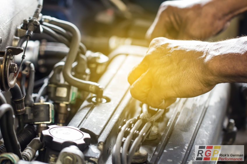 Close up mechanical man dirty hands using tool to fix repair car engine, maintenance vehicle service concept.